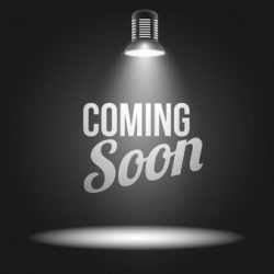 coming-soon-message-illuminated-with-light-projector_1284-3622
